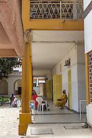 Dakar, Senegal.  Dakar Hospital.  Family Members Waiting outside a Patient's Room.