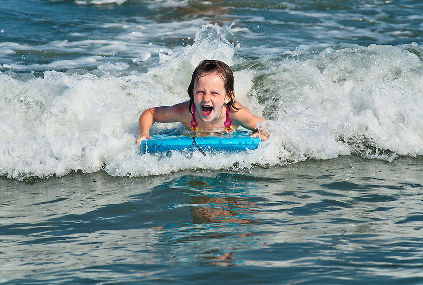 Young girl enjoys the ocean water.