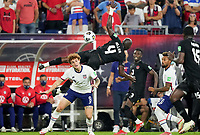 NASHVILLE, TN - SEPTEMBER 5: Kamal Miller #4 of Canada goes over the top of osh Sargent #9 of USA during a game between Canada and USMNT at Nissan Stadium on September 5, 2021 in Nashville, Tennessee.
