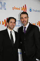 Ron Carlivati (R) (head writer for One Life To Live) and partner David Rogal at the 21st Annual GLAAD Media Awards on March 13, 2010 at the New York Marriott Marquis, New York City, NY. (Photo by Sue Coflin/Max Photos)