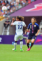 August 06, 2012..France's Elodie Thomis #12 and Japan's Nahomi Kawasumi #9 during Semi Final match at the Wembley Stadium on day ten in Wembley, England. Japan defeats France 2-1 to reach Women's Finals of the 2012 London Olympics.