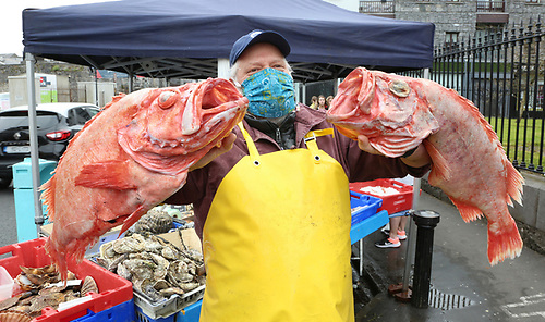Stefan Griesbach of Gannet Fishmongers in Galway holds up the rare Golden Redfish landed in County Donegal