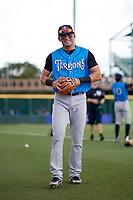 Tampa Tarpons Angel Aguilar (7) walks to the dugout before a game against the Bradenton Marauders on August 12, 2018 at LECOM Park in Bradenton, Florida.  The game was suspended in the bottom of the first inning due to weather.  (Mike Janes/Four Seam Images)