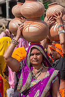 Abhaneri, Rajasthan, India.  Women Carrying Pots on their Heads as they Participate in a Pre-wedding Celebration.