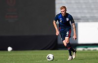 GUADALAJARA, MEXICO - MARCH 28: Justen Glad #4 of the United States dribbles with the ball during a game between Honduras and USMNT U-23 at Estadio Jalisco on March 28, 2021 in Guadalajara, Mexico.