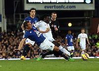 Liverpool, UK. Saturday 01 November 2014<br /> Pictured: Bafetimbi Gomis (R) against Phil Jagielka of Everton (L).<br /> Re: Premier League Everton v Swansea City FC at Goodison Park, Liverpool, Merseyside, UK.