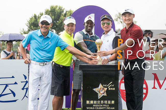 (L-R)  He Ping, Zhao Hongbo, Dwight Yorke, Tenniel Chu, Li Haotong at the 1st hole during the World Celebrity Pro-Am 2016 Mission Hills China Golf Tournament on 23 October 2016, in Haikou, China. Photo by Weixiang Lim / Power Sport Images