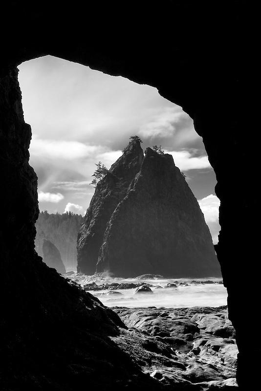 Split Rock as seen through arch at Rialto Beach. Olympic National Park, Washington