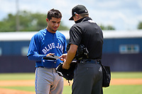 FCL Blue Jays pitcher Guillermo Villasmil (20) gets checked for foreign substances by umpire Takashi Wada during a game against the FCL Yankees on June 29, 2021 at the Yankees Minor League Complex in Tampa, Florida.  (Mike Janes/Four Seam Images)