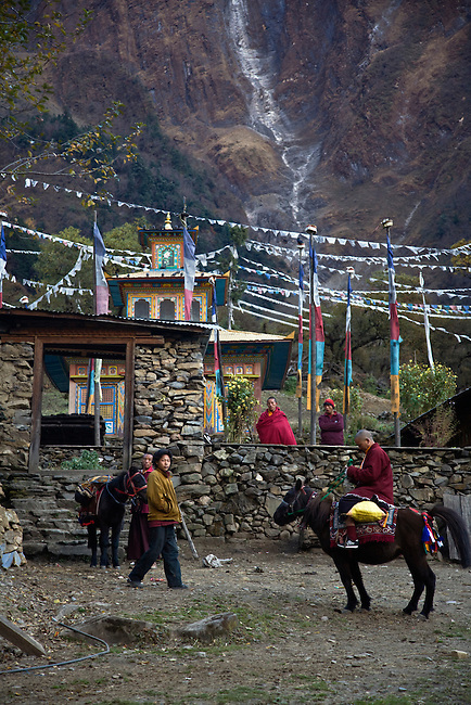 Villagers deliver supplies by horse to a remote TIBETAN BUDDHIST MONASTERY - NEPAL HIMALAYA