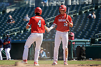 Izaac Pacheco (34) congratulates Bubba Chandler (4) after scoring a run during the Baseball Factory All-Star Classic at Dr. Pepper Ballpark on October 4, 2020 in Frisco, Texas.  Bubba Chandler (4), a resident of Bogart, Georgia, attends North Oconee High School.  (Mike Augustin/Four Seam Images)