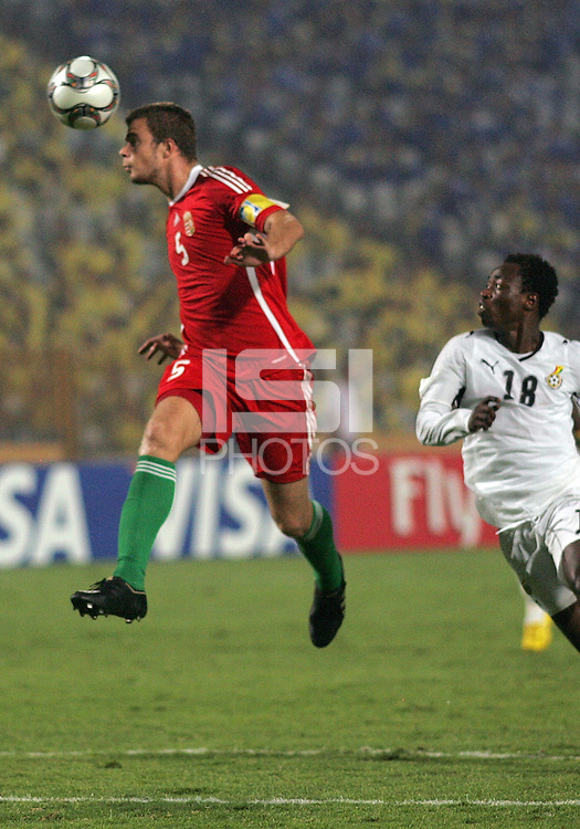 Hungary's  Andras Debreceni (5) takes control of the ball against Ghana's Ransford Osei (18) during the FIFA Under 20 World Cup Semi-final match at the Cairo International Stadium in Cairo, Egypt, on October 13, 2009. Costa Rica won the match 1-2 in overtime play. Ghana won the match 3-2.