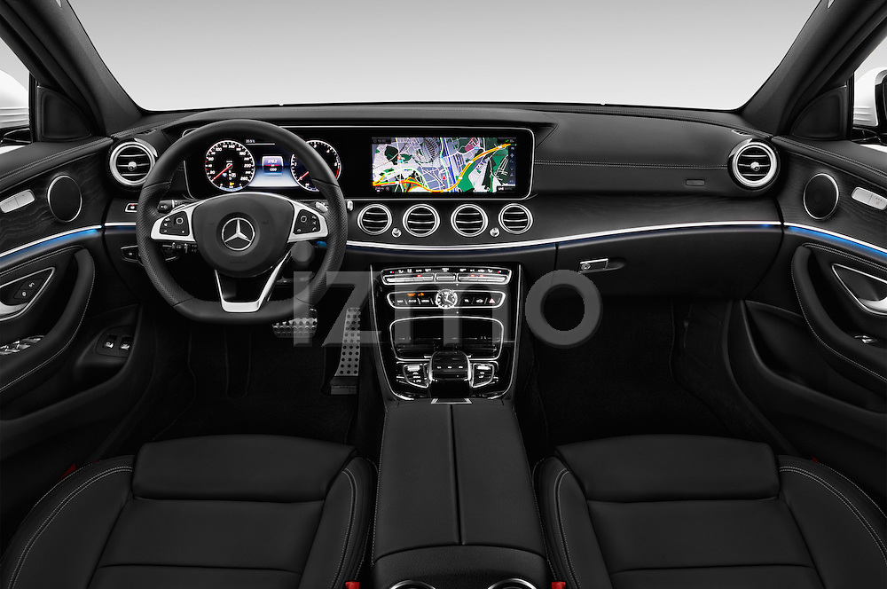 Stock photo of straight dashboard view of 2017 Mercedes Benz E-Class Launch-Edition 5 Door wagon Dashboard