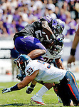 TCU Horned Frogs running back Matthew Tucker (29) and Virginia Cavaliers linebacker Steve Greer (53) in action during the game between the Virginia Cavaliers and the TCU Horned Frogs  at the Amon G. Carter Stadium in Fort Worth, Texas. TCU defeats Virginia 27 to 7...
