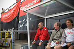Crusaders 1 Fulham 3, 16/07/2011. Seaview Park, Europa League 2nd qualifying round first leg. Fulham manager Martin Jol sitting with members of his coaching staff in the technical area as his team takes to the pitch at Seaview Park, Belfast before their UEFA Europa League 2nd qualifying round, first leg match against Northern Irish club Crusaders. The visitors from England won by 3 goals to 1 before a crowd of 3011. Photo by Colin McPherson.