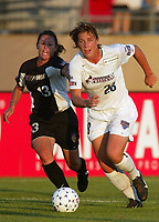 Abby Wambach of the Washington Freedom is chased by Jen Lalor of the NY Power. The Freedom defeated the Power 4-2 on Saturday August 10, at Mitchel Athletic Complex, Uniondale, NY.