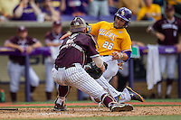 LSU Tigers first baseman Chris Chinea (26) slides home attempt to avoid Texas A&M catcher Michael Barash (5) during the Southeastern Conference baseball game on April 25, 2015 at Alex Box Stadium in Baton Rouge, Louisiana. Texas A&M defeated LSU 6-2. (Andrew Woolley/Four Seam Images)