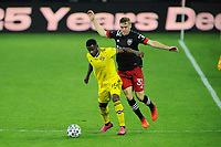 WASHINGTON, DC - OCTOBER 28: Waylon Francis #14 of Columbus Crew SC battles for the ball with Julian Gressel #31 of D.C. United during a game between Columbus Crew and D.C. United at Audi Field on October 28, 2020 in Washington, DC.