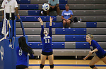 From left, Marymount's Cailyn Thomas, Bri Fitzpatrick, Johanna Hummel compete in a college volleyball match at Washington & Lee University Lexington, Vir., on Saturday, Oct. 5, 2013.<br /> Photo by Cathleen Allison