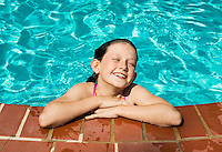 Candid portrait of a girl swimming.