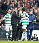 Efe Ambrose gets a pat on the back from Ronny Deila after being red carded