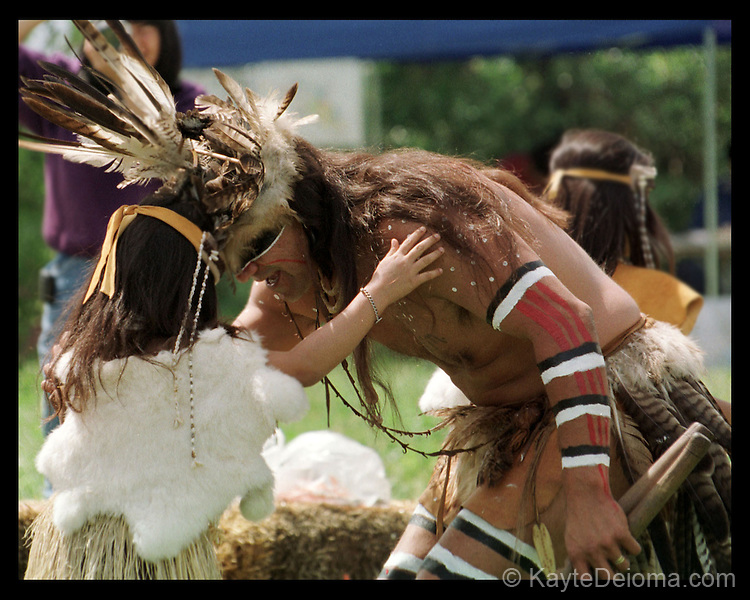 A Chumash elder touches heads with a Gabrileno/Tongva girl at a gathering of California Indians at the Peter Strauss Ranch in the Santa Monica Mountains in Southern California