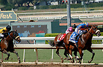 """ARCADIA, CA  SEP 27:  #3 Harvest Moon, ridden by Flavien Prat, passes #1 Fighting Mad, ridden by Luis Saez, with a fast closing #5 Hard Not to Love, ridden by Mike Smith, in the stretch of the Zenyatta Stakes (Grade ll) """"Win and You're Breeders' Cup Distaff Division"""" on September 27, 2020 at Santa Anita Park in Arcadia, CA. (Photo by Casey Phillips/Eclipse Sportswire/CSM."""