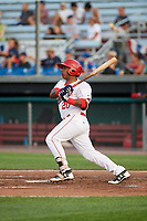 Auburn Doubledays designated hitter Israel Pineda (20) hits a single during a game against the Lowell Spinners on July 13, 2018 at Falcon Park in Auburn, New York.  Lowell defeated Auburn 8-5.  (Mike Janes/Four Seam Images)
