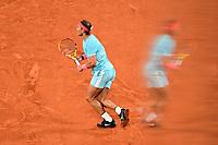 11th October 2020, Roland Garros, Paris, France; French Open tennis, mens singles final 2020; Double exposure as Rafael Nadal Esp returns to Djokovic