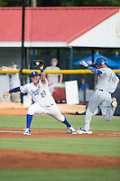 Burlington Royals first baseman Logan Nottebrok (27) stretches for a throw as Andrew Florides (14) of the Bluefield Blue Jays steps on the base at Burlington Athletic Stadium on June 28, 2016 in Burlington, North Carolina.  The Royals defeated the Blue Jays 4-0.  (Brian Westerholt/Four Seam Images)