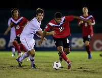 Zachary Carroll (17) of the United States tries to slow down Jordan Allen (15) of Canada during the finals of the CONCACAF Men's Under 17 Championship at Catherine Hall Stadium in Montego Bay, Jamaica. The United States defeated Canada, 3-0, in overtime