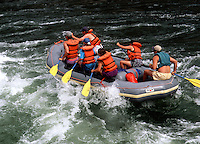 Whitewater rafting through rapids in the Salmon River. Idaho.