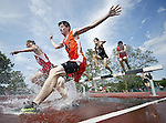 New Britain, CT 15- June 2011-061511JH01- Emmett Rafferty(front) and Quinton Hoey (back) from Watertown compete steeplechase in section one during the boy's decathlon Wednesday afternoon in Willow Brook Park in New Britain.    Junfu Han Republican-American
