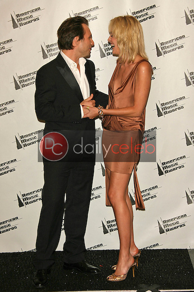 Christian Slater and Sharon Stone<br />in the press room at the 34th Annual American Music Awards. Shrine Auditorium, Los Angeles, CA. 11-21-06<br />Dave Edwards/DailyCeleb.com 818-249-4998