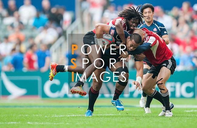 Japan vs Trinidad & Tobago during the Cathay Pacific / HSBC Hong Kong Sevens at the Hong Kong Stadium on 28 March 2014 in Hong Kong, China. Photo by Juan Flor / Power Sport Images