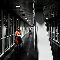 An employee walks along a footbridge connecting buildings at the European Parliament. Every month thousands of parliamentary staff travel between the three sites of government in Brussels, Strasbourg and Luxembourg.