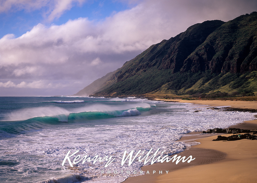 Waves breaking on beach, Yokohama Bay, Oahu, Hawaii, USA.