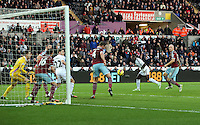 Pictured: A header by Bafetimbi Gomis of Swansea goes wide Saturday 10 January 2015<br /> Re: Barclays Premier League, Swansea City FC v West Ham United at the Liberty Stadium, south Wales, UK