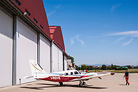 Aero Club Bresso (Milano). Aereo da turismo Piper presso gli Hangar --- Bresso Airfield flying club near Milan. General aviation Piper aircraft by the Hangars