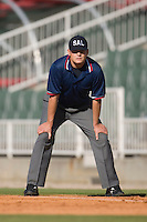 Umpire Jason Hutchings works the bases during a South Atlantic League game between the Asheville Tourists and the Kannapolis Intimidators at Fieldcrest Cannon Stadium April 12, 2009 in Kannapolis, North Carolina. (Photo by Brian Westerholt / Four Seam Images)
