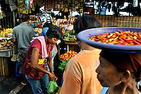 A food market at the waterfront in Ambon, where Christian and Muslim traders work alongside each other. The 1999-2002 religious war between Maluku's Christian and Muslim populations, mainly centred on Ambon Island, led to over 5000 deaths and to around 500,000 people become displaced. Destroyed homes and offices, churches and mosques are slowly being either torn-down or renovated.  Urban centres, such as Ambon City, continue to be split along largely sectarian lines, and tensions are never far below the surface. Riots between Christian and Muslim youths erupted in September 2011 and, most recently, June 2012, though luckily simmered down just as quickly, partly due to community leaders learning how to defuse tensions from the earlier, more devastating, conflagration. /Felix Features