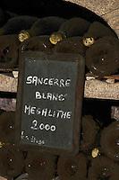 Bottles aging in the cellar. Cuvee Megalithe 2000. Domaine de la Perriere, Sancerre, Loire, France