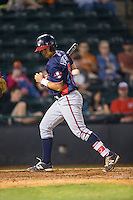 Lucas Herbert (14) of the Rome Braves spins away from an inside pitch during the game against the Hickory Crawdads at L.P. Frans Stadium on May 12, 2016 in Hickory, North Carolina.  The Braves defeated the Crawdads 3-0.  (Brian Westerholt/Four Seam Images)
