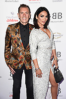 Duncan Bannatyne and Nigora Bannatyne<br /> arriving for Caudwell Butterfly Ball 2019 at the Grosvenor House Hotel, London<br /> <br /> ©Ash Knotek  D3508  13/06/2019
