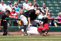 Louisville Bats Third Baseman Todd Frazier (30) covers the bag as Trevor Plouffe slides in during a game vs. the Rochester Red Wings Sunday, May 16, 2010 at Frontier Field in Rochester, New York.   Rochester defeated Louisville by the score of 4-3.  Photo By Mike Janes/Four Seam Images