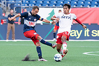FOXBOROUGH, MA - JUNE 26: Rio Ramirez #24 of North Texas SC intercepts an attempt to pass by Jake Rozhansky #32 of the New England Revolution during a game between North Texas SC and New England Revolution II at Gillette Stadium on June 26, 2021 in Foxborough, Massachusetts.
