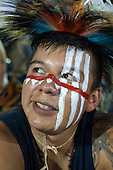 A Native American contestant from the USA with white and red face paint  prepares for his next event during the International Indigenous Games in Brazil. 27th October 2015
