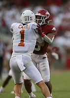 Arkansas defensive back Greg Brooks Jr. (9) stops Texas quarterback Hudson Card (1), Saturday, September 11, 2021 during the second quarter of a football game at Reynolds Razorback Stadium in Fayetteville. Check out nwaonline.com/210912Daily/ for today's photo gallery. <br /> (NWA Democrat-Gazette/Charlie Kaijo)
