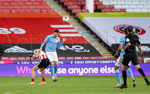 31st October 2020; Bramall Lane, Sheffield, Yorkshire, England; English Premier League Football, Sheffield United versus Manchester City; Aymeric Laporte of Manchester City heads the ball forward above Oliver McBurnie of Sheffield United