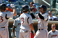 Luis Domoromo #25 of the Lake Elsinore Storm is congratulated  after hitting a home run against the Lancaster JetHawks at Clear Channel Stadium on April 15, 2012 in Lancaster,California. Lake Elsinore defeated Lancaster 7-5.(Larry Goren/Four Seam Images)
